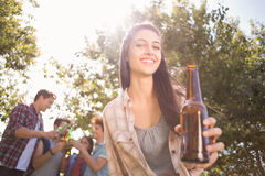 Happy friends in the park having beers Stock Photo