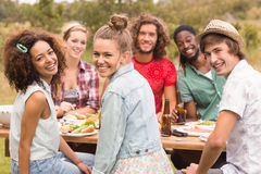 Happy friends in the park having lunch Royalty Free Stock Photo