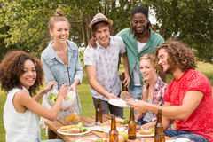 Happy friends in the park having lunch Royalty Free Stock Photos