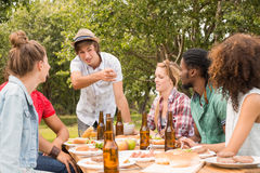 Happy friends in the park having lunch Royalty Free Stock Images