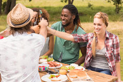 Happy friends in the park having lunch Royalty Free Stock Photography