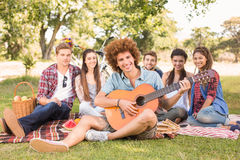 Happy friends in the park having picnic Royalty Free Stock Photo