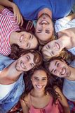 happy friends in a park huddling in circle Royalty Free Stock Photos