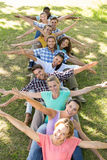 Happy friends in the park playing games Stock Photography