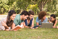 Happy friends in the park studying Royalty Free Stock Images