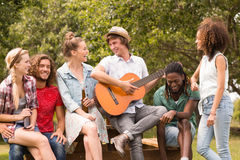 Happy friends in the park Stock Image