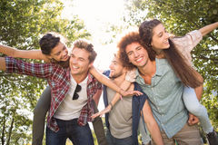 Happy friends in the park taking selfie Stock Photos