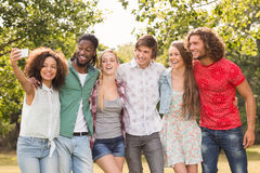 Happy friends in the park taking selfie Stock Image