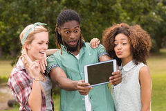 Happy friends in the park taking selfie Royalty Free Stock Photos