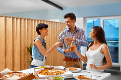 Happy Friends At Party Celebrating Holiday. Friendship, Leisure, Royalty Free Stock Photos