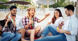 Friends partying and having fun on beach at summer. Happy friends partying and having fun on beach at summer stock photography