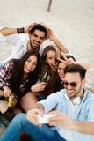 Friends partying and having fun on beach at summer. Happy friends partying and having fun on beach at summer royalty free stock images
