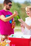 Happy friends on picnic party Stock Photos