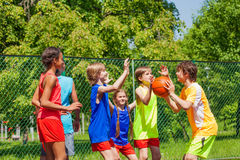 Happy friends playing basketball game outside Royalty Free Stock Photo