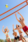 Happy friends playing beach volley Royalty Free Stock Photos