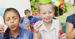 Happy friends playing with bubble wand in backyard 4k stock video footage