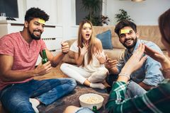 Happy friends playing game guess stock photo