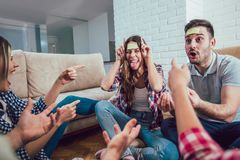 Happy friends playing game guess who and having fun royalty free stock images