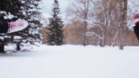 Happy friends playing with snow in winter stock footage