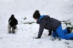 Happy friends playing in the in snow Stock Photos