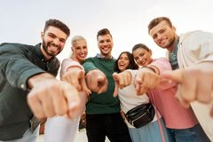 Happy friends pointing finger at you royalty free stock photo