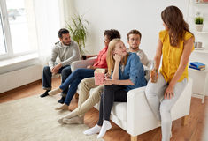 Happy friends with popcorn and beer at home Royalty Free Stock Photo