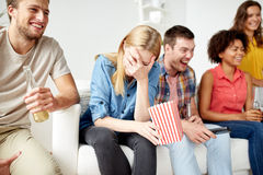 Happy friends with popcorn and beer at home Stock Photo