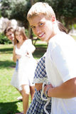 Happy Friends pulling a rope against each other. Men on focus Royalty Free Stock Images