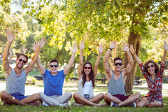 Happy friends raising their hands in the park Royalty Free Stock Photo