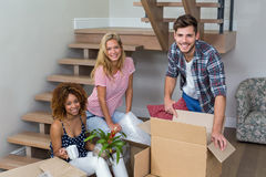 Happy friends relocating at new house Stock Images