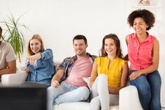 Happy friends with remote watching tv at home Royalty Free Stock Photo