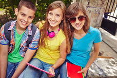 Happy friends. Restful teens on summer vacations Stock Photography