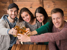 Happy friends resting with alcohol drinks in cafe Royalty Free Stock Image