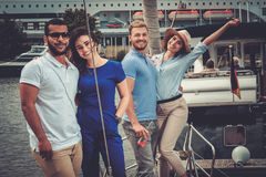 Happy friends resting on a yacht Stock Photos