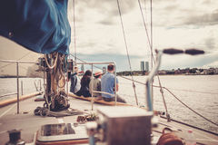 Happy friends resting on a yacht Stock Image
