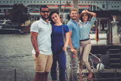 Happy friends resting on a yacht Stock Photo