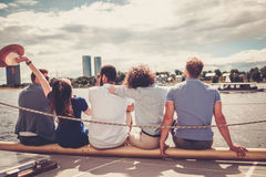 Happy friends resting on a yacht Royalty Free Stock Photography