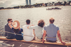 Happy friends resting on a yacht Stock Photography
