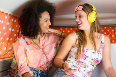 Happy friends on a road trip using listening to music Royalty Free Stock Image