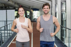 Happy friends running together Royalty Free Stock Photography