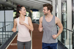 Happy friends running together Royalty Free Stock Photo