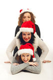 Happy friends with Santa hat piled up Royalty Free Stock Photos