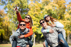 Happy friends in shades having fun at autumn park Royalty Free Stock Image