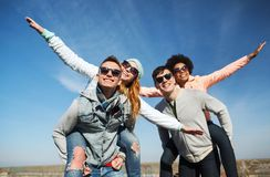 Happy friends in shades having fun outdoors Stock Photos