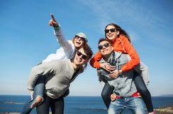 Happy friends in shades having fun outdoors Royalty Free Stock Photo