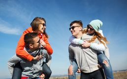 Happy friends in shades having fun outdoors Royalty Free Stock Photography
