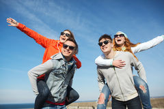 Happy friends in shades having fun outdoors Stock Image
