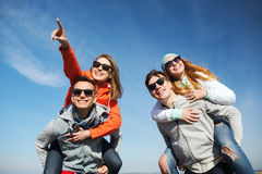 Happy friends in shades having fun outdoors Stock Photography