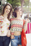 Happy friends with shopping bags. Happy female friends with shopping bags Stock Image