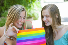 Happy friends with shopping bags Stock Photography
